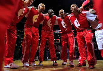 CHICAGO, IL - DECEMBER 01: (L-R) Omer Asik #3, Carlos Boozer #5, Loul Deng #9, Keith Bogans #6 and Derrick Rose #1 of the Chicago Bulls gather in a huddle after player introductions before a game against the Orlando Magic at the United Center on December
