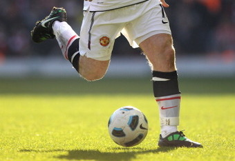 Setting up for another right-footed touch outside of his body, without protecting the ball or beguiling the defender in the slightest.