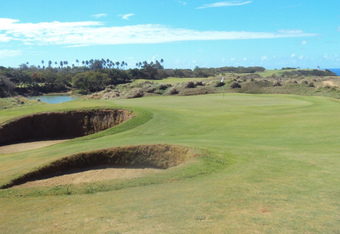 The deep sod faced bunkers guarding the 10th green. Can there be a Hell bunker in Paradise?
