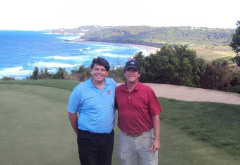 Golf writer andy Reistetter with Stanley Pasarell on the 17th green at Royal Isabela.