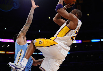 Kobe shoots a fadeaway against the Nuggets