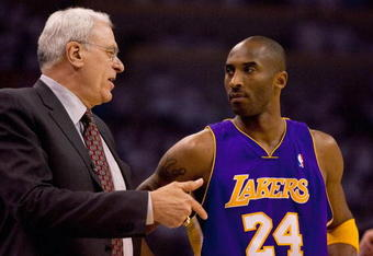 Phil Jackson discusses the game with Kobe Bryant