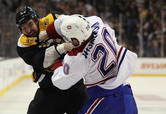 BOSTON, MA - APRIL 16:  Shane Hnidy #34 of the Boston Bruins and James Wisniewski #20 of the Montreal Canadiens fight in the second period in Game Two of the Eastern Conference Quarterfinals during the 2011 NHL Stanley Cup Playoffs at TD Garden on April 1