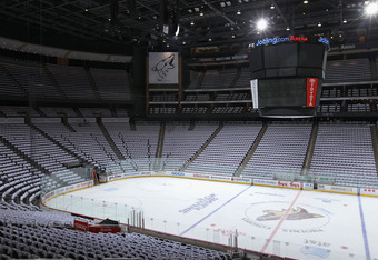 "A picture's worth a Thousand Words? No, that's not 20 minutes before puck-drop, that so-called ""White-Out"" was a promotional stunt where the T-shirts were provided prior to the game for a crowd overwhelming for Detroit"