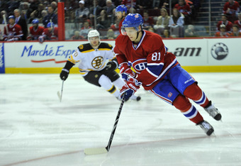 MONTREAL, CANADA - APRIL 18:  Lars Eller #81 of the Montreal Canadiens turns up ice with the puck while being pursued by Daniel Paille #20 of the Boston Bruins in Game Three of the Eastern Conference Quarterfinals during the 2011 NHL Stanley Cup Playoffs
