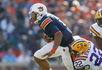 Former Auburn QB Cam Newton runs with the ball during Auburn's 24-17 win over LSU in 2010. Is Russell Wilson the heir to Newton's throne?