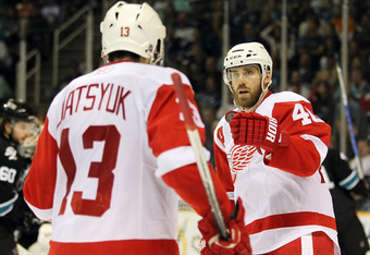 SAN JOSE, CA - MAY 01:  Henrik Zetterberg #40 and Pavel Datsyuk #13 of the Detroit Red Wings celebrate after Henrik Zetterberg scored a goal against the San Jose Sharks in Game Two of the Western Conference Semifinals during the 2011 NHL Stanley Cup Playo