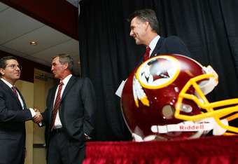 Washington Redskins owner Daniel Snyder with head coach Mike Shanahan and GM Bruce Allen on the day they were introduced.  Since then, Snyder has been busy, but not with personnel decisions.