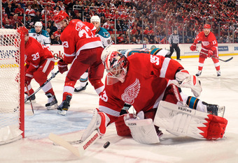 DETROIT - MAY 4:  Goaltender Jimmy Howard #35 of the Detroit Red Wings makes a save against the San Jose Sharks in Game Three of the Western Conference Semifinals during the 2011 NHL Stanley Cup Playoffs on May 4, 2011 at Joe Louis Arena in Detroit, Michi