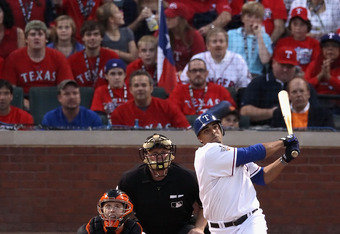 ARLINGTON, TX - OCTOBER 30:  Nelson Cruz #17 of the Texas Rangers hits a double against the San Francisco Giants during the second inning of Game Three of the 2010 MLB World Series at Rangers Ballpark on October 30, 2010 in Arlington, Texas.  The Rangers