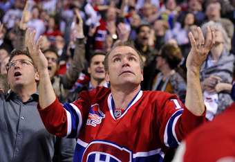 MONTREAL, CANADA - APRIL 26:  A Montreal Canadiens fan reacts to a goal being waved off in a game between the Boston Bruins and the Montreal Canadiens in Game Six of the Eastern Conference Quarterfinals during the 2011 NHL Stanley Cup Playoffs at the Bell