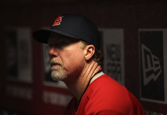 PHOENIX, AZ - APRIL 12:  Batting coach Mark McGwire of the St. Louis Cardinals watches from the dugout during the Major League Baseball game against the Arizona Diamondbacks at Chase Field on April 12, 2011 in Phoenix, Arizona.  The Diamondbacks defeated