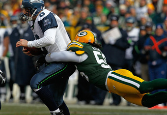 GREEN BAY, WI - DECEMBER 27: Nick Barnett #56 of the Green Bay Packers sacks Matt Hasselbeck #8 of the Seattle Seahawks at Lambeau Field on December 27, 2009 in Green Bay, Wisconsin. (Photo by Jonathan Daniel/Getty Images)