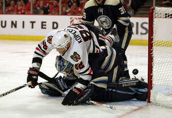 CHICAGO, IL - FEBRUARY 18: Tomas Kopecky #82 of the Chicago Blackhawks falls over Steve Mason #1 of the Columbus Blue Jackets and is called for goaltender interference at the United Center on February 18, 2011 in Chicago, Illinois. (Photo by Jonathan Dani