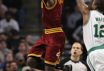 BOSTON, MA - JANUARY 25:  Christian Eyenga #8 of the of the Cleveland Cavaliers heads for the basket and fouled by Von Wafer #12 of the Boston Celtics on January 25, 2011 at the TD Garden in Boston, Massachusetts. The Celtics defeated the Cavaliers 112-95