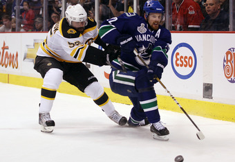 VANCOUVER, BC - JUNE 01:  Daniel Sedin #22 of the Vancouver Canucks skates against Johnny Boychuk #55 of the Boston Bruins during game one of the 2011 NHL Stanley Cup Finals at Rogers Arena on June 1, 2011 in Vancouver, Canada.  (Photo by Bruce Bennett/Ge