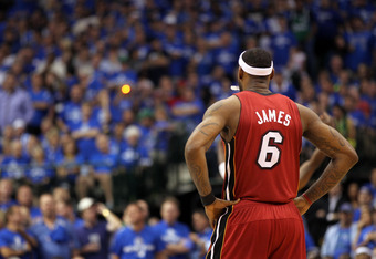 DALLAS, TX - JUNE 05:  LeBron James #6 of the Miami Heat stands on the court against the Dallas Mavericks in Game Three of the 2011 NBA Finals at American Airlines Center on June 5, 2011 in Dallas, Texas.  NOTE TO USER: User expressly acknowledges and agr