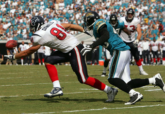 JACKSONVILLE, FL - SEPTEMBER 28: Owen Daniels #81 of the Houston Daniels attempts a reception against Gerald Sensabaugh #43 of the Jacksonville Jaguars at Jacksonville Municipal Stadium on September 28, 2008 in Jacksonville, Florida. (Photo by Sam Greenwo