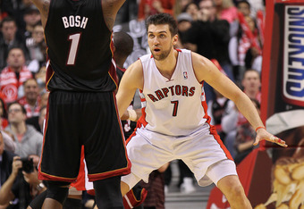 TORONTO, CAN - FEBRUARY 16:  Chris Bosh #1 of the Miami Heat looks to shoot against Andrea Bargnani #7 of the Toronto Raptors in a game on February 16, 2011 at the Air Canada Centre in Toronto, Canada. The Heat defeated the Raptors 103-95. (Photo by Claus
