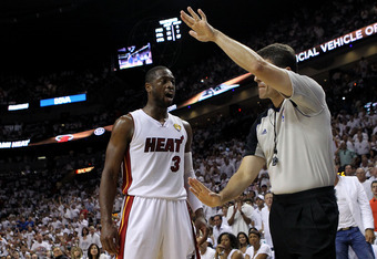 MIAMI, FL - JUNE 12:  Dwyane Wade #3 of the Miami Heat is called for a technical foul by referee Scott Foster #48 in the third quarter against the Dallas Mavericks in Game Six of the 2011 NBA Finals at American Airlines Arena on June 12, 2011 in Miami, Fl