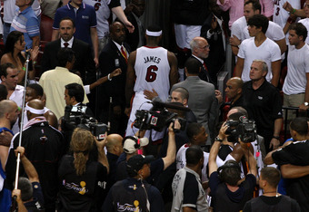 MIAMI, FL - JUNE 12:  LeBron James #6 of the Miami Heat walks off the court after the Dallas Mavericks won 105-95 in Game Six of the 2011 NBA Finals at American Airlines Arena on June 12, 2011 in Miami, Florida. NOTE TO USER: User expressly acknowledges a