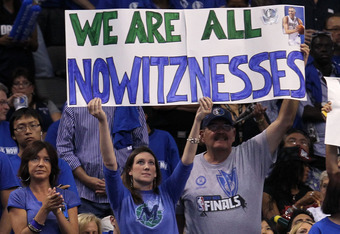 DALLAS, TX - JUNE 09:  Fans of the Dallas Mavericks hold up asign which reads  'We are all Nowitznessess in reference to Dirk Nowitzki #41 of the Mavericks against the Miami Heat in Game Five of the 2011 NBA Finals at American Airlines Center on June 9, 2