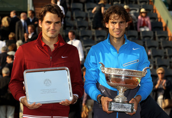 PARIS, FRANCE - JUNE 05:  (L to R) Runner up Roger Federer of Switzerland and Champion Rafael Nadal of Spain pose following the men's singles final match between Rafael Nadal of Spain and Roger Federer of Switzerland on day fifteen of the French Open at R