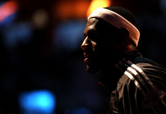 MIAMI, FL - JUNE 12:  LeBron James #6 of the Miami Heat looks on during the national anthem before Game Six of the 2011 NBA Finals between the Heat and the Dallas Mavericks at American Airlines Arena on June 12, 2011 in Miami, Florida. NOTE TO USER: User