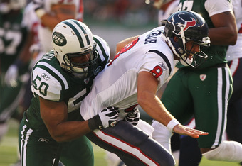 EAST RUTHERFORD, NJ - NOVEMBER 21:  Vernon Gholston #50 of the New York Jets Tackles Matt Shaub #8 of the Houston Texans during their  game on November21, 2010 at the New Meadowlands Stadium  in East Rutherford, New Jersey.  (Photo by Al Bello/Getty Image