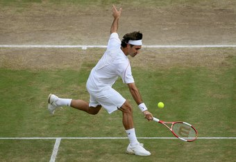 LONDON - JULY 07:  Roger Federer of Switzerland returns a backhand to Jonas Bjorkman of Sweden in their semi-final match during day eleven of the Wimbledon Lawn Tennis Championships at the All England Lawn Tennis and Croquet Club on July 7, 2006 in London