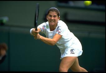 4 JUL 1992:  MONICA SELES OF SERBIA STRETCHES TO REACH A HIGH BACKHAND DURING THE WOMENS FINAL AGAINST STEFFI GRAF OF GERMANY AT THE 1992 WIMBLEDON TENNIS CHAMPIONSHIPS. GRAF WON THE MATCH 6-2, 6-1.