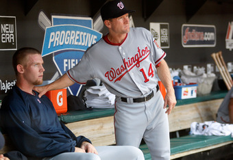 CLEVELAND - JUNE 13:  Stephen Strasburg #37 of the Washington Nationals is consoled by batting coach Rick Eckstein #14 while sitting in the dugout after being pulled from the game against the Cleveland Indians on June 13, 2010 at Progressive Field in Clev