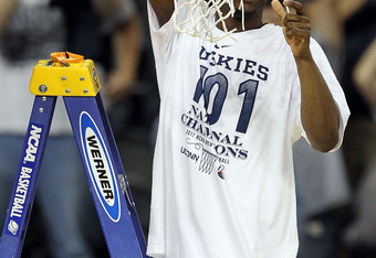 April 4, 2011: Walker sliced down the nets and displayed them as an NCAA Tournament champion in Houston.