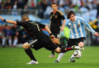 CAPE TOWN, SOUTH AFRICA - JULY 03:  Lionel Messi of Argentina evades the tackle by Bastian Schweinsteiger of Germany during the 2010 FIFA World Cup South Africa Quarter Final match between Argentina and Germany at Green Point Stadium on July 3, 2010 in Ca