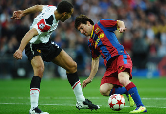 LONDON, ENGLAND - MAY 28:  Lionel Messi of FC Barcelona takes on Rio Ferdinand of Manchester United during the UEFA Champions League final between FC Barcelona and Manchester United FC at Wembley Stadium on May 28, 2011 in London, England.  (Photo by Laur