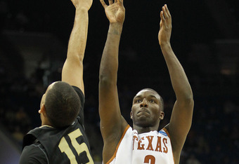 TULSA, OK - MARCH 18:  Jordan Hamilton #3 of the Texas Longhorns takes a shot as Drew Valentine #15 of the Oakland Golden Grizzlies defends during the second round of the 2011 NCAA men's basketball tournament at BOK Center on March 18, 2011 in Tulsa, Okla