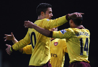 LONDON, ENGLAND - JANUARY 15:  Robin van Persie of Arsenal celebrates scoring the opening goal with Theo Walcott during the Barclays Premier League match between West Ham United and Arsenal at the Boleyn Ground on January 15, 2011 in London, England.  (Ph