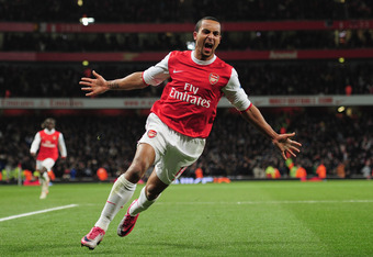 LONDON, ENGLAND - DECEMBER 27:  Theo Walcott of Arsenal celebrates Arsenal's third goal during the Barclays Premier League match between Arsenal and Chelsea at the Emirates Stadium on December 27, 2010 in London, England.  (Photo by Shaun Botterill/Getty