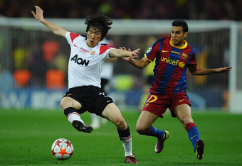 LONDON, ENGLAND - MAY 28:  Pedro of FC Barcelona battles with Park Ji-Sung  of Manchester United during the UEFA Champions League final between FC Barcelona and Manchester United FC at Wembley Stadium on May 28, 2011 in London, England.  (Photo by Laurenc