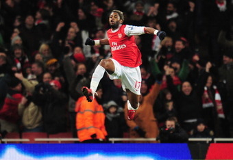 LONDON, ENGLAND - DECEMBER 27: Alex Song of Arsenal celebrates scoring the opening goal during the Barclays Premier League match between Arsenal and Chelsea at the Emirates Stadium on December 27, 2010 in London, England.  (Photo by Shaun Botterill/Getty