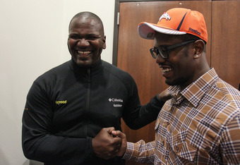ENGLEWOOD, CO - APRIL 29:  Von Miller of the Denver Broncos is congratulated by former Bronco linebacker and defensive end Alfred Williams at Dove Valley on April 29, 2011 in Englewood, Colorado. Miller, a projected outside linebacker in head coach John F