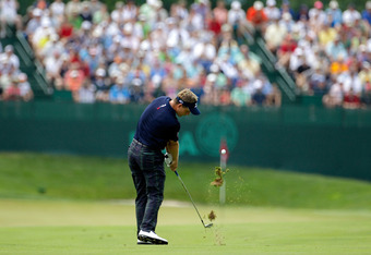 BETHESDA, MD - JUNE 18:  Luke Donald of England hits his second shot on the fifth hole during the third round of the 111th U.S. Open at Congressional Country Club on June 18, 2011 in Bethesda, Maryland.  (Photo by Rob Carr/Getty Images)