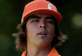 BETHESDA, MD - JUNE 13:  Rickie Fowler watches a shot during a practice round prior to the start of the 111th U.S. Open at Congressional Country Club on June 13, 2011 in Bethesda, Maryland.  (Photo by Ross Kinnaird/Getty Images)