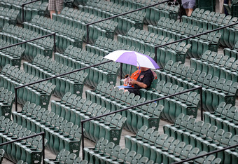 BALTIMORE, MD - JUNE 12:  Fans sit in the stands through the rain before the game between the Tampa Bay Rays and the Baltimore Orioles at Oriole Park at Camden Yards on June 12, 2011 in Baltimore, Maryland.  (Photo by Greg Fiume/Getty Images)