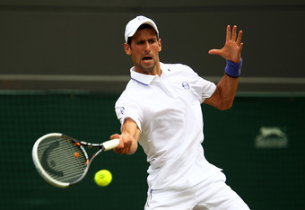 LONDON, ENGLAND - JUNE 27:  Novak Djokovic of Serbia returns a shot during his fourth round match against  Michael Llodra of France on Day Seven of the Wimbledon Lawn Tennis Championships at the All England Lawn Tennis and Croquet Club on June 27, 2011 in