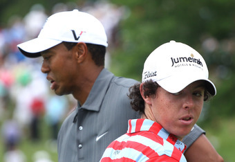 DUBLIN, OH - JUNE 02:  Tiger Woods (L) and Rory McIlroy of Northern Ireland wait in a fairway during the Memorial Skins Game prior to the start of the 2010 Memorial Tournament at the Muirfield Village Golf Club on June 2, 2010 in Dublin, Ohio.  (Photo by