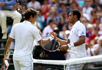 LONDON, ENGLAND - JUNE 29:  Jo-Wilfried Tsonga (R) of France shakes hands with Roger Federer of Switzerland after winning his quarterfinal round match on Day Nine of the Wimbledon Lawn Tennis Championships at the All England Lawn Tennis and Croquet Club o