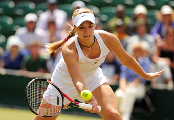 LONDON, ENGLAND - JUNE 29:  Sabine Lisicki of Germany in action while playing with Samantha Stosur of Australia during their double's match against Sorana Cirstea of Romania and Ayumi Morita of Japan on Day Nine of the Wimbledon Lawn Tennis Championships