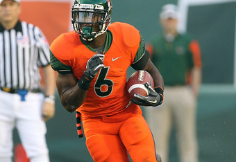 MIAMI - NOVEMBER 20:  Lamar Miller #6 of the Miami Hurricanes runs for a touchdown during a game against the Virginia Tech Hokies at Sun Life Stadium on November 20, 2010 in Miami, Florida.  (Photo by Mike Ehrmann/Getty Images)
