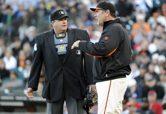 SAN FRANCISCO, CA - JUNE 26: Manager Bruce Bochy (R) of the San Francisco Giants argues with home plate umpire Hunter Wendelstedt (L) over a batted ball called fair for the Cleveland Indians in the six inning during a MLB baseball game at AT&T Park June 2